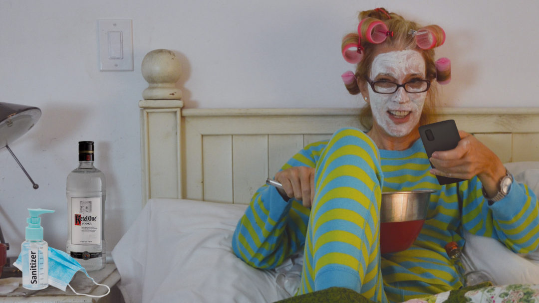 Bored Pcharlotte drinking vodka, surfing on phone in bed with facial mask and rollers.